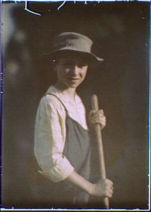 boy 1912 with a hoe