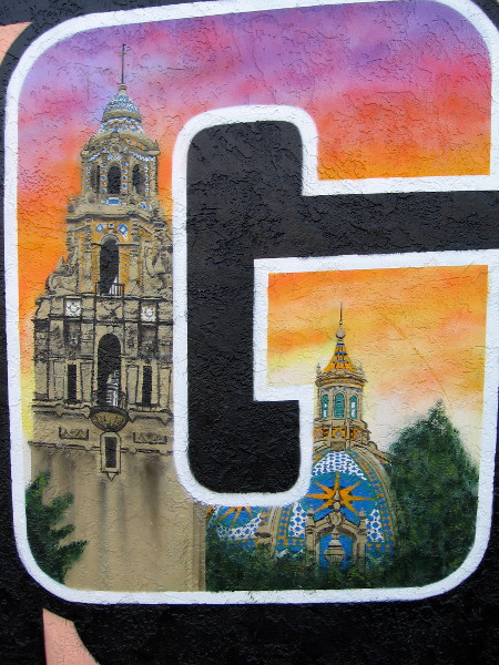 Balboa Park's iconic California Building and bell tower appear in the letter G in the same colorful North Park mural.