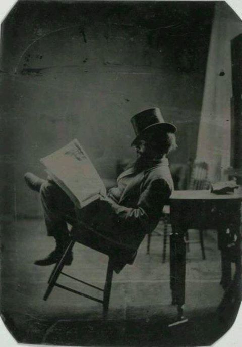man newspaper chair 1880