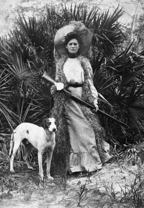 woman with shotgun and dog 1910