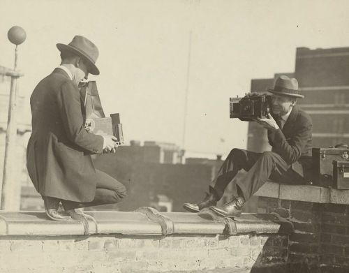 2 photographers 1930s on roof