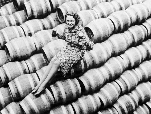 woman with beer barrels