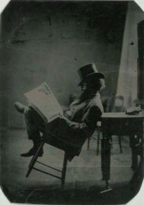 man newspaper chair 1880
